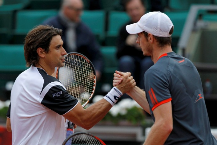 Ferrer of Spain shakes hands with Murray of Britain after winning his quarter-final match during the French Open tennis tournament at the Roland Garros stadium in Paris