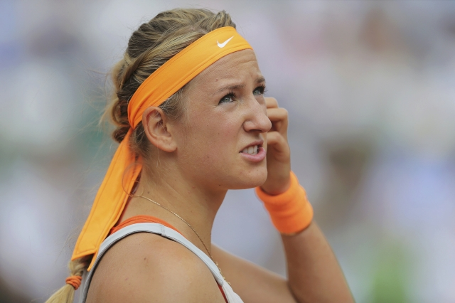 Azarenka of Belarus reacts during her women's singles semi-final match against Sharapova of Russia at the French Open tennis tournament in Paris