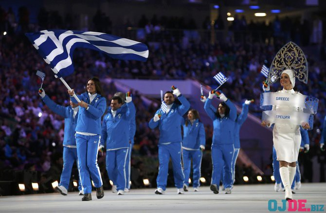 Greece's flag-bearer Panagiota Tsakiri leads her delegation as they march in during the opening ceremony of the 2014 Sochi Winter Olympics